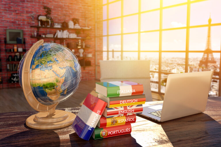 Image of globe and language books in the post how translation services benefit tourism